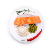 Salmon steak with rice and peas Stock Photography