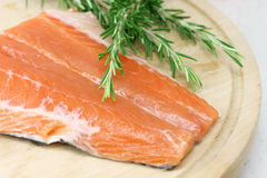 Salmon steak with rosemary Stock Photos