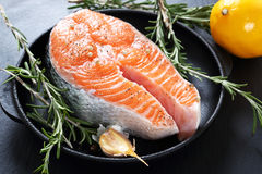 Salmon steak with rosemary Stock Photography
