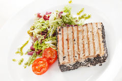 Salmon steak with salad Stock Images