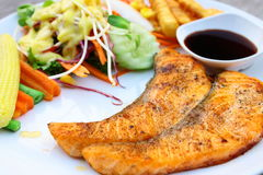 Salmon steak and salad Royalty Free Stock Images