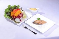 Salmon steak with salad Stock Photo