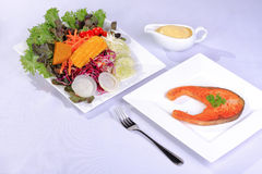 Salmon steak with salad Stock Photography