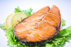 Salmon steak with salad and lemon Royalty Free Stock Images