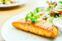 Salmon steak. Salmon meat fillet steak with vegetable salad in white plate Stock Photo