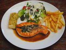 Salmon steak seafood with vegetable and french fries. Salmon steak seafood with vegetable Stock Image