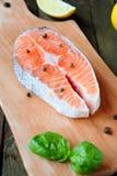 Salmon steak and seasoning Stock Photos
