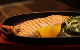 Salmon steak served with spinach Stock Photography