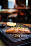 Salmon steak served on a warm plate Stock Image