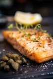 Salmon steak served on a warm plate Stock Photo