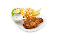 The Salmon steak with a side dish of salad Royalty Free Stock Photos