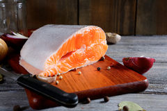 Salmon steak slices on a cutting board. Cooking concept. And healthy food Royalty Free Stock Photo