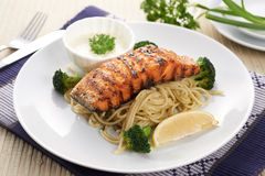 Salmon steak with spaghetti Royalty Free Stock Images
