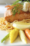 Salmon steak with spaghetti on dish in restaurant Royalty Free Stock Photos