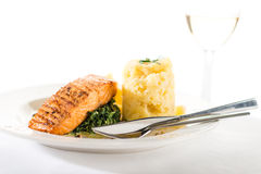 Salmon steak with spinach and mashed potatoes Stock Photo