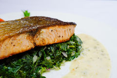 Salmon steak on spinach, selective focus Royalty Free Stock Photo