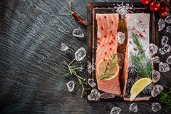Salmon steak on stone table. Delicious salmon steak on stone table, close-up royalty free stock photography