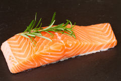 Salmon steak with twig of rosemary Stock Photo