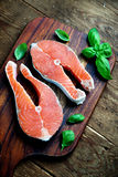 Salmon steak. Two pieces of red salmon fillets placed on the wooden cutting board Royalty Free Stock Photos