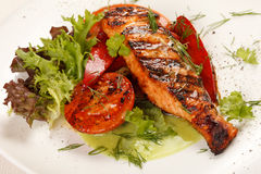 Salmon steak with vegetables Stock Image