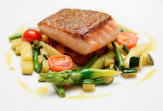 Salmon steak with vegetables Royalty Free Stock Images