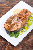 Salmon steak with vegetables Stock Images
