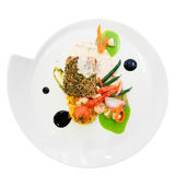 Salmon steak with vegetables in plate isolated on white Stock Photo