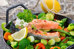 Salmon steak on vegetables Royalty Free Stock Image
