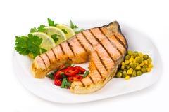 Salmon steak with vegetables Stock Photos