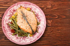 Salmon steak, veggies and herbs Royalty Free Stock Image