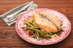 Salmon steak, veggies and herbs Royalty Free Stock Photos