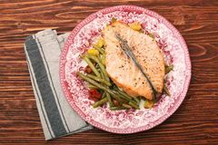 Salmon steak, veggies and herbs Stock Photography