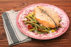 Salmon steak, veggies and herbs Royalty Free Stock Photography