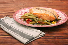 Salmon steak, veggies and herbs Stock Image