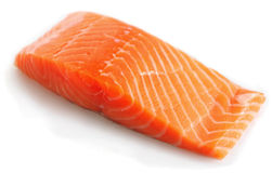 Salmon steak on white with light shadow Royalty Free Stock Photography