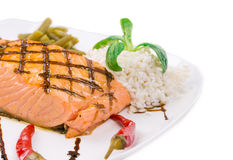 Salmon steak on white plate Stock Photography