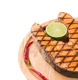 Salmon steak on wooden board Stock Photos