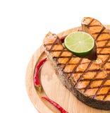 Salmon steak on wooden board Stock Photos