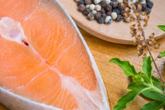 Salmon steak on wooden board Royalty Free Stock Photography