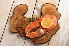 Salmon steak on wooden board Royalty Free Stock Image