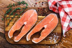 Salmon steak on a wooden board Royalty Free Stock Images