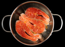 Salmon steaks being marinated in pot, isolated Stock Photos
