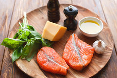 Salmon steaks with cheese and fresh ingredients Royalty Free Stock Photo
