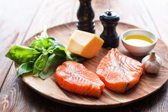 Salmon steaks with cheese and fresh ingredients Stock Photo