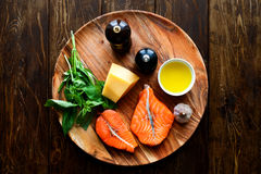 Salmon steaks with cheese and fresh ingredients Stock Image