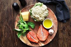 Salmon steaks with fresh ingredients Stock Images