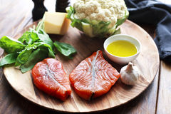 Salmon steaks with fresh ingredients Royalty Free Stock Photo