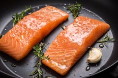Salmon Steaks Fresh and Raw in Frying Pan stock images