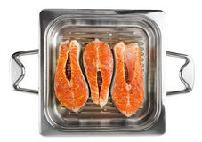 Salmon steaks in grill pan ready for cooking, isolated Stock Images