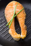 Salmon steaks in the iron pan Royalty Free Stock Photography